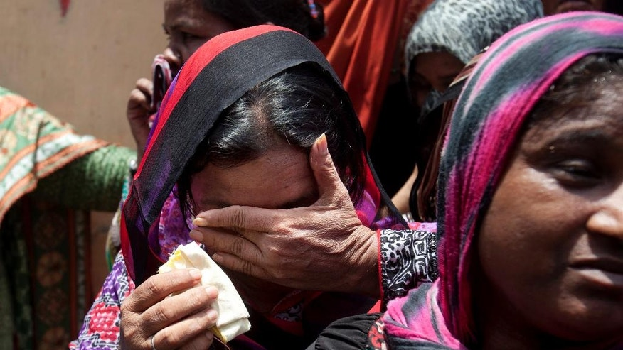 Women mourn during the funeral of Pakistani Sufi singer Amjad Sabri in Karachi, Pakistan, Thursday, June 23, 2016. Thousands of mourners are attending the funeral of a well-known Pakistani Sufi singer who was shot dead in the port city of Karachi in an attack claimed by Islamic extremists. (AP Photo/Shakil Adil)