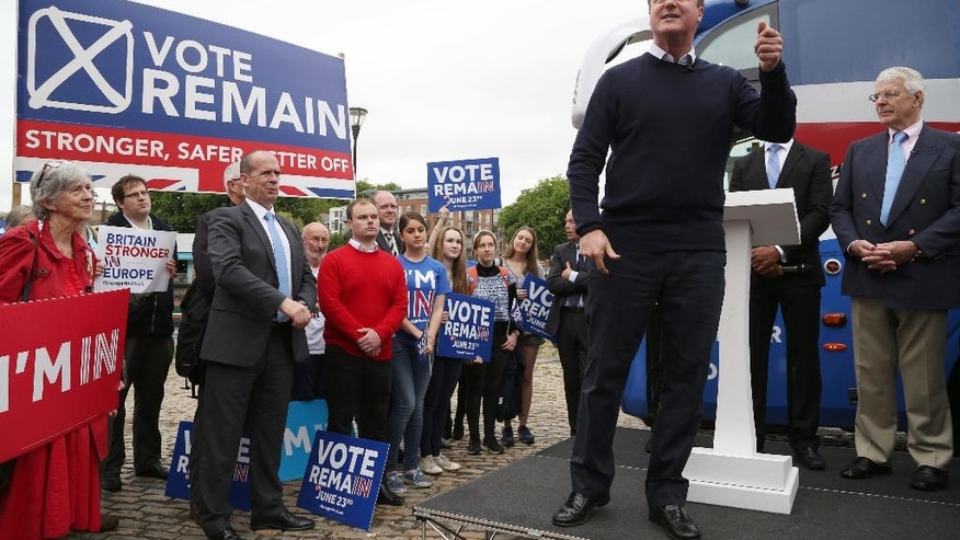 Britain's Prime Minister David Cameron,  foreground,  addresses Vote Remain supporters with  former Prime Minister John Major, right, during a rally in Bristol, England Wednesday June 22, 2016. On Thursday Britain goes to the polls in a referendum  on whether to remain or leave  the EU . (Geoff Caddick/PA via AP) UNITED KINGDOM OUT