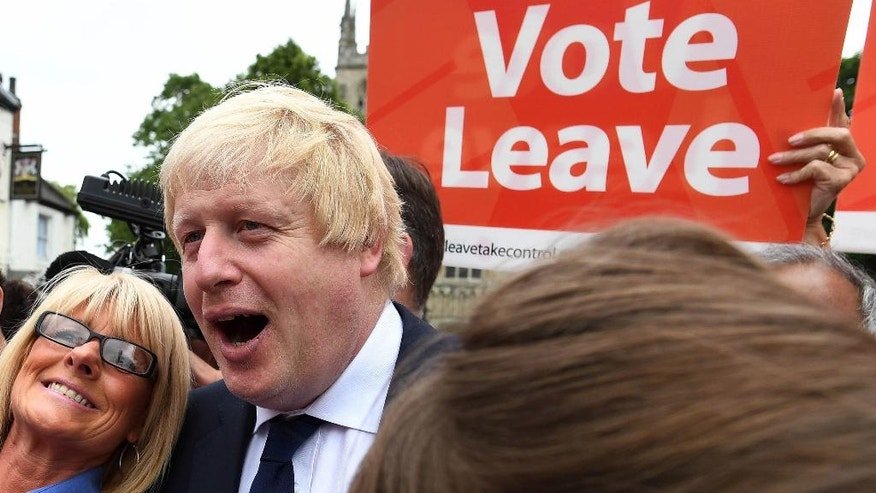 Advocate to exit Europe Boris Johnson poses for a selfie photo with voters  during a whistle stop tour of the country on the final day of campaigning before Thursday's EU referendum vote, in Selby, north England, Wednesday June 22, 2016. On Thursday Britain votes in a national referendum on whether to stay inside the EU, a momentous decision with far-reaching implications for Britain and Europe. (Andrew Parsons / PA via AP) UNITED KINGDOM OUT - NO SALES - NO ARCHIVES