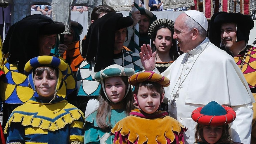 Pope Francis poses for photos with members of  'Giostra del Saracino'  a historical group from Arezzo, Italy,  at the end of his weekly general audience in St. Peter's Square at the Vatican, Wednesday, June 22, 2016.  (AP Photo/Fabio Frustaci)
