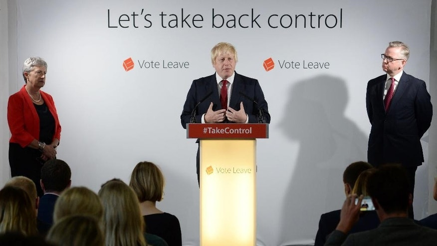 Vote Leave campaigners Gisela Stuart, left, Boris Johnson, centre, and Michael Gove  hold a press conference at Vote Leave headquarters  in London Friday June 24, 2016.  Britain's Prime Minister David Cameron announced Friday  that he will quit as Prime Minister following a defeat in the referendum which ended with a vote for Britain to leave the European Union. (Stefan Rousseau/Pool via AP)
