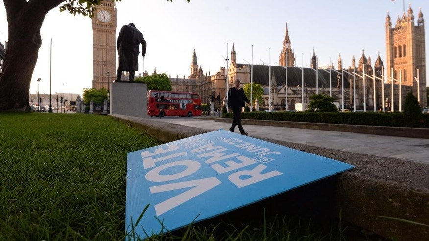 A Vote Remain poster lies discarded on the ground in London's Parliament Square, Friday, June 24, 2016. Britain entered uncharted waters Friday after the country voted in a referendum to leave the European Union, according to a projection by all main U.K. broadcasters.  (Stefan Rousseau/PA via AP) UNITED KINGDOM OUT, NO SALES, NO ARCHIVE