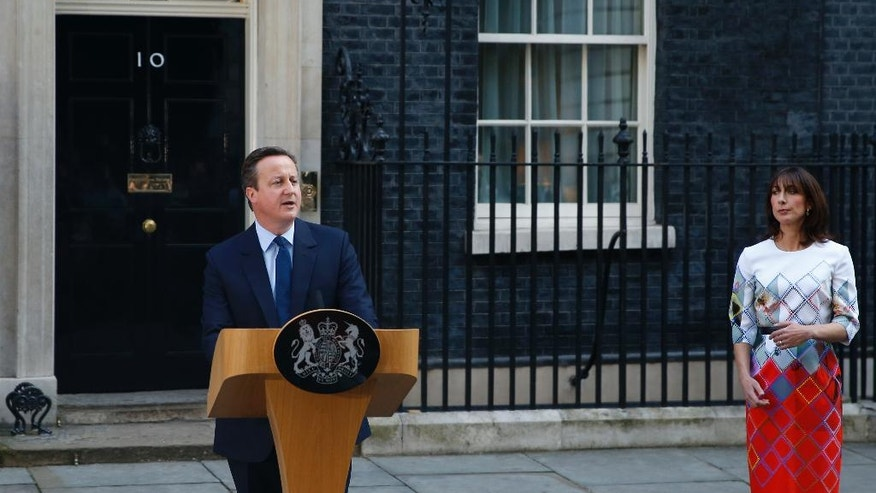Britain's Prime Minister David Cameron, accompanied by his wife, Samantha, speaks to the media in front of 10 Downing street, London, Friday, June, 24, 2016, as he announces he will resign by the time of the Conservative Party conference in the autumn, following the result of the EU referendum, in which the Britain voted to leave the EU. (AP Photo/Alastair Grant)