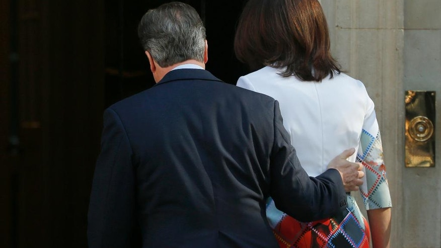 Britain's Prime Minister David Cameron, and his wife Samantha, walk back into 10 Downing Street, London, after speaking to the media Friday, June, 24, 2016, where he announced he will resign by the time of the Conservative Party conference in the autumn, following the result of the EU referendum, in which the Britain voted to leave the EU. (AP Photo/Alastair Grant)