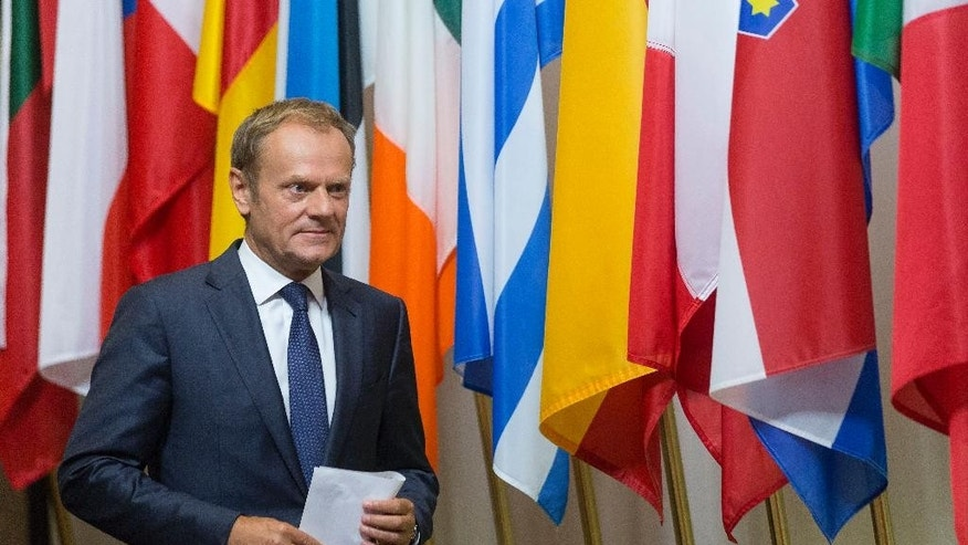 European Council President Donald Tusk prepares to address a media conference at the EU Council building in Brussels on Friday, June 24, 2016. Top European Union officials were hunkering down in Brussels Friday to try to work out what to do next after the shock decision by British voters to leave the 28-nation bloc. (AP Photo/Thierry Monasse)