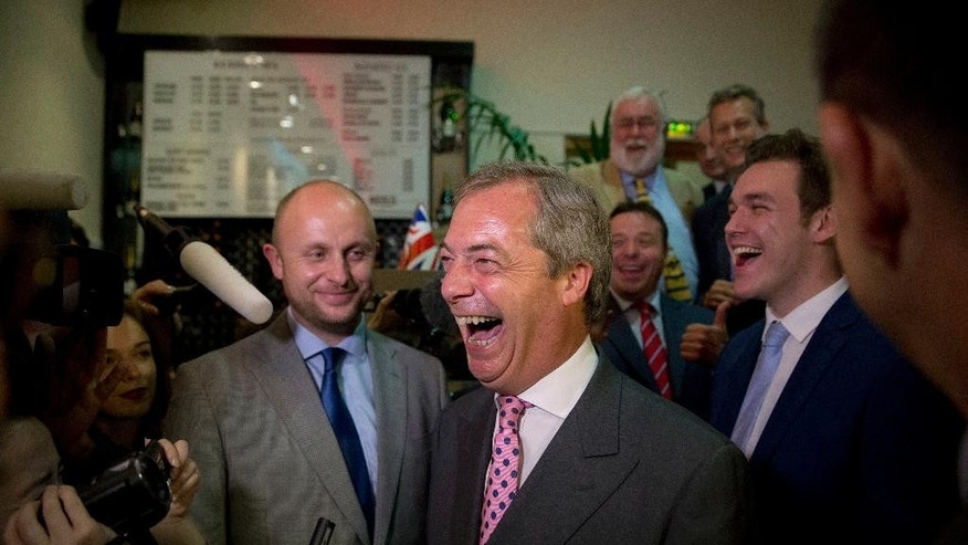 "Nigel Farage, the leader of the UK Independence Party, reacts in celebration at a ""Leave.EU"" organization party for the British European Union membership referendum in London, Friday, June 24, 2016. Farage said he thinks the ""leave"" side will win in Britain's historic referendum on European Union membership. (AP Photo/Matt Dunham)"