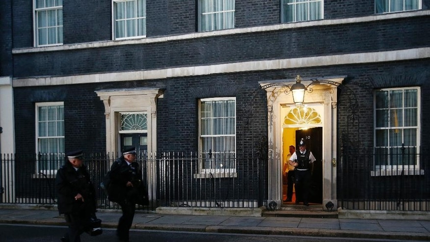 Police walk past door of 10 Downing street, as counting of the votes cast in the EU referendum are counted, Friday, June 24, 2016. The results of the referendum, that was held Thursday, will be known early Friday. (AP Photo/Alastair Grant)