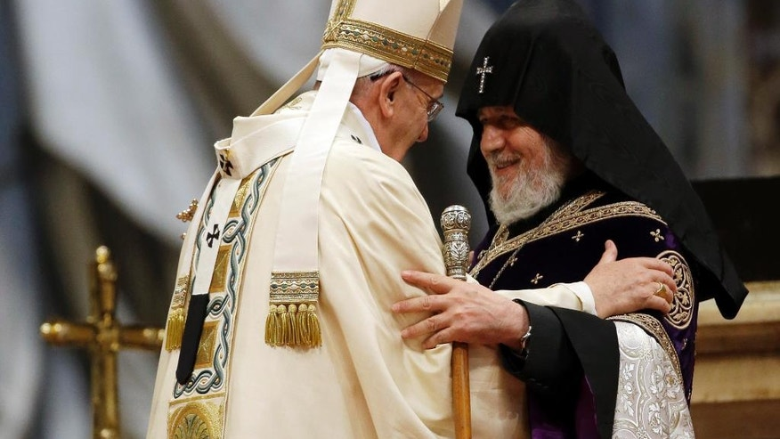 FILE - In this Sunday, April 12, 2015 file photo, Pope Francis, left, is greeted by the head of Armenia's Orthodox Church Karekin II, during an Armenian-Rite Mass on the occasion of the commemoration of the 100th anniversary of the Armenian Genocide, in St. Peter's Basilica, at the Vatican. Pope Francis is making his first foray into the former Soviet Union with a weekend visit to Armenia, a year after he riled Turkey by declaring the Ottoman-era slaughter of Armenians genocide and amid fresh tensions with rival Azerbaijan. (AP Photo/Gregorio Borgia, File)