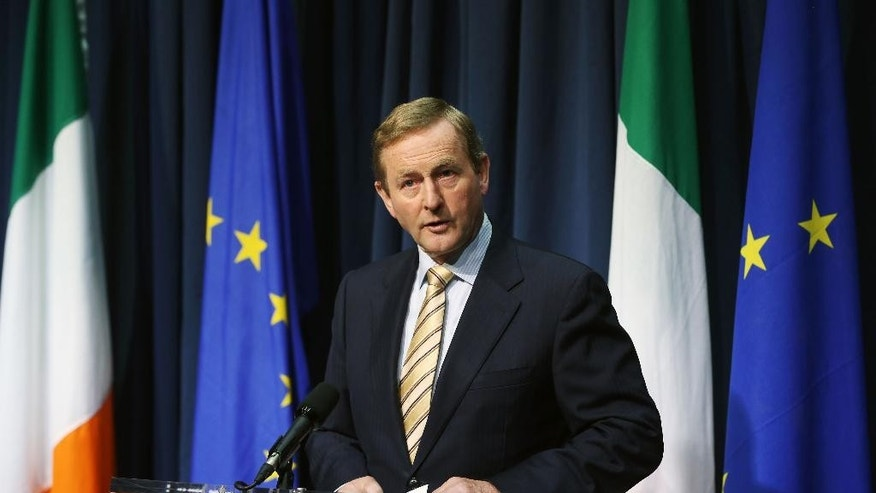 Irish Prime Miinister  Enda Kenny speaks during a press conference in Dublin Friday June 24, 2016 after Britain voted to leave the European Union in an historic referendum. (Niall Carson/PA via AP) UNITED KINGDOM OUT