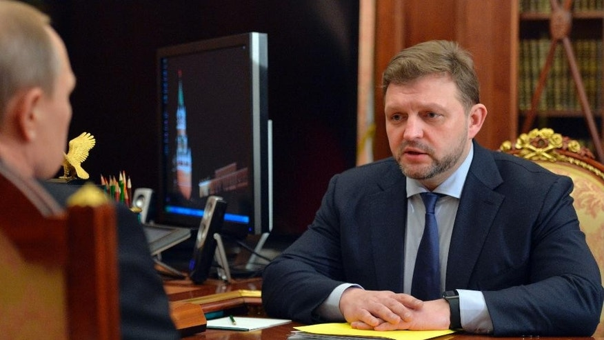 In this photo taken Monday, Feb. 1, 2016 Russian President Vladimir Putin, left, meets with Kirov regional governor Nikita Belykh in the Novo-Ogaryovo residence outside Moscow, Russia. Russia's top investigative agency said Belykh has been arrested on charges of taking a bribe. (Alexei Nikolsky/Sputnik, Kremlin Pool Photo via AP)