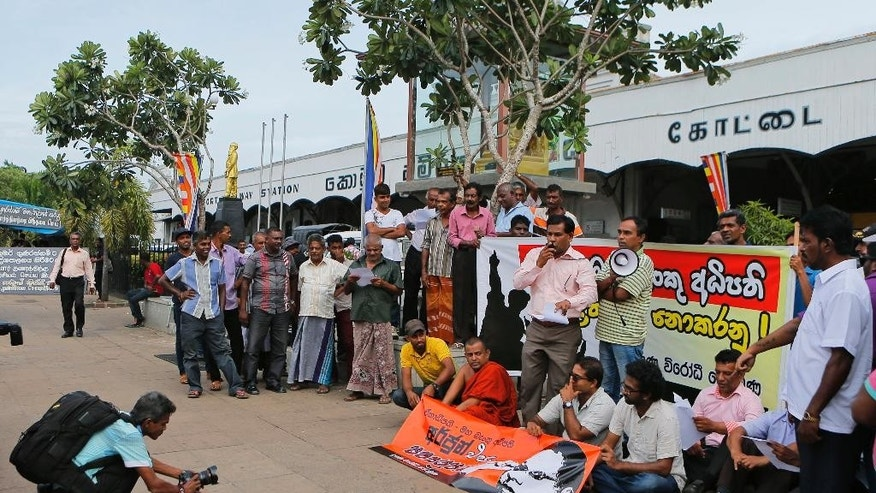 In this Thursday, June 23. 2016 photo, Sri Lankan anti-corruption activists stage a protest against the governor of the central bank over his corruption allegations which the governor has denied, in Colombo, Sri Lanka. Sri Lankan lawmakers are close to giving citizens the right to demand public information, a move many hope will restore transparency and good governance to a nation that has for long been plagued by corruption and misrule. (AP Photo/Eranga Jayawardena)