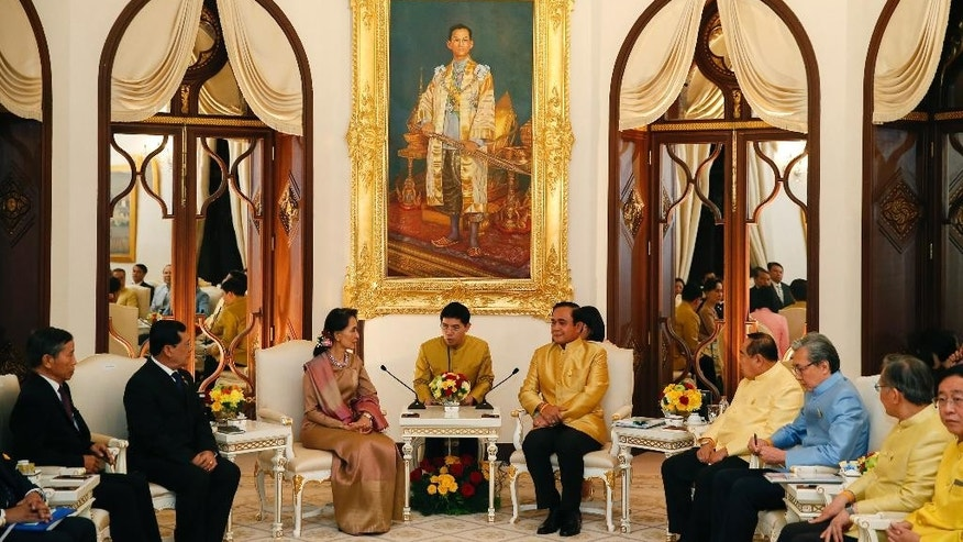 Thai Prime Minister Prayuth Chan-ocha, fifth right, and Myanmar's Foreign Minister and State Counselor Aung San Suu Kyi, third left, attend a meeting at government house in Bangkok, Thailand, June 24, 2016. Myanmar's de facto leader  Suu Kyi met with Prayuth to sign memorandums of understanding over the processing of and the treatment of Myanmar migrant workers in Thailand, who labor in menial jobs and often in exploitative conditions. (Jorge Silva/Pool Photo via AP)