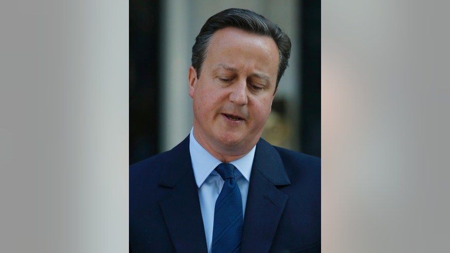 Britain's Prime Minister David Cameron speaks to the media in front of 10 Downing street, as he goes on to announce his resignation following the result of the EU referendum, in which the Britain voted to leave the EU, in London, Friday, June, 24, 2016. (AP Photo/Alastair Grant)