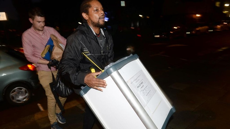 A ballot box is carried into the Royal Horticultural Halls in London as counting gets underway in the referendum on the UK's membership of the European Union, Thursday June 23, 2016. On Thursday Britain votes in a national referendum on whether to stay inside the EU. (Anthony Devlin / PA via AP) UNITED KINGDOM OUT - NO SALES - NO ARCHIVES