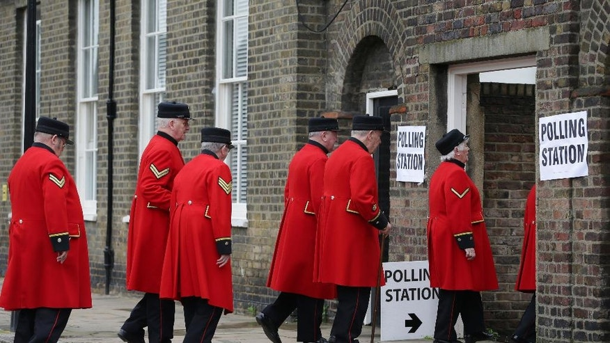 Chelsea pensioners arrive at a polling station near to the Royal Chelsea Hospital, London, to vote in Britain's EU referendum Thursday June 23, 2016. Voters in Britain are deciding Thursday whether the country should remain in the European Union  a historic referendum that threatens to undermine the experiment in continental unity that began in the aftermath of World War II. (Daniel Leal-Olivas/PA via AP) UNITED KINGDOM OUT