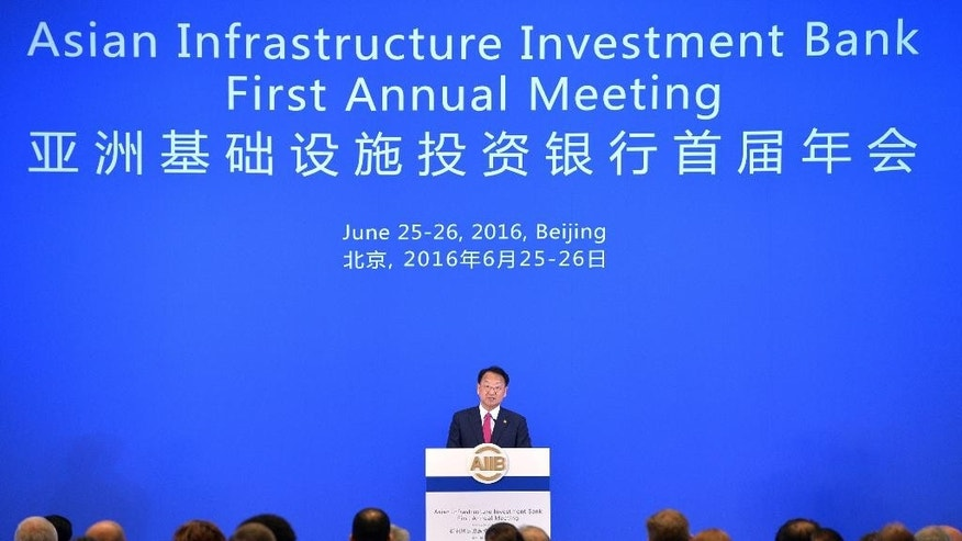 In this photo released by China's Xinhua News Agency, South Korea's Deputy Prime Minister Yoo Il-ho speaks at the opening ceremony of the first annual meeting of the Board of Governors of the Asian Infrastructure Investment Bank (AIIB) in Beijing, Saturday, June 25, 2016. Yoo called on governments to show the value of international cooperation as a Chinese-led Asian infrastructure investment bank held its first annual meeting following Britain's vote to leave the European Union. (Li Xin/Xinhua via AP) NO SALES