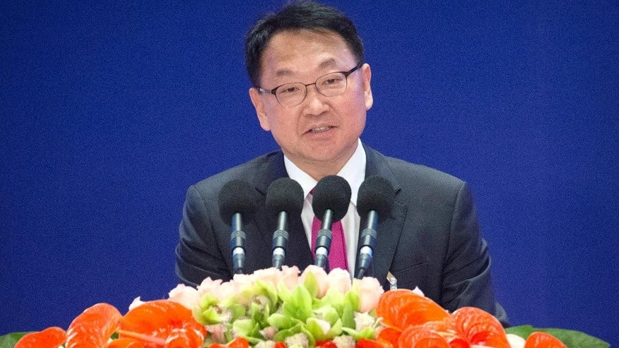 FILE - In this Jan. 16, 2016, file photo, South Korean Finance Minister Yoo Il-ho speaks during the opening ceremony of the Asian Infrastructure Investment Bank (AIIB) in Beijing. Yoo on Saturday, June 25, 2016, has called on governments to show the value of international cooperation as a Chinese-led Asian infrastructure investment bank held its first annual meeting following Britain's vote to leave the European Union. (AP Photo/Mark Schiefelbein, Pool, File)