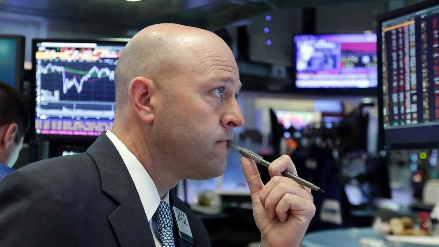 Specialist Jay Woods works on the floor of the New York Stock Exchange, Friday, June 24, 2016. The Dow Jones industrial average dropped 611 points, or 3.4 percent, to 17,399 in heavy trading Friday. Stocks plunged in the U.S. and worldwide after Britain voted to leave the European Union. (AP Photo/Richard Drew)