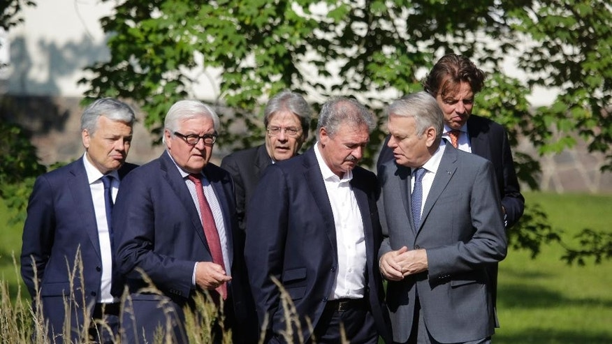 Foreign Ministers from EU's founding six, from left to right,  Didier Reynders from Belgium, Frank-Walter Steinmeier from Germany, Paolo Gentiloni from Italy, Jean Asselborn from Luxembourg, Jean-Marc Ayrault from France and Bert Koenders from the Netherlands, walk through the park of the Foreign Ministry's guest house Villa Borsig during a meeting to talk about Brexit in Berlin, Saturday, June 25, 2016.  Top diplomats from the European Union's six founding nations met in Berlin on Saturday for hastily arranged talks following Britain's stunning vote to leave the bloc. (AP Photo/Markus Schreiber)