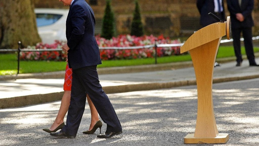 FILE - In this Friday, June 24, 2016 file photo, Britain's Prime Minister David Cameron and his wife Samantha walk back into 10 Downing Street, London, after speaking to the media. Cameron says he will resign by the time of the party conference in the fall after Britain voted to leave the European Union after a bitterly divisive referendum campaign, according to tallies of official results Friday. (AP Photo/Matt Dunham, File)