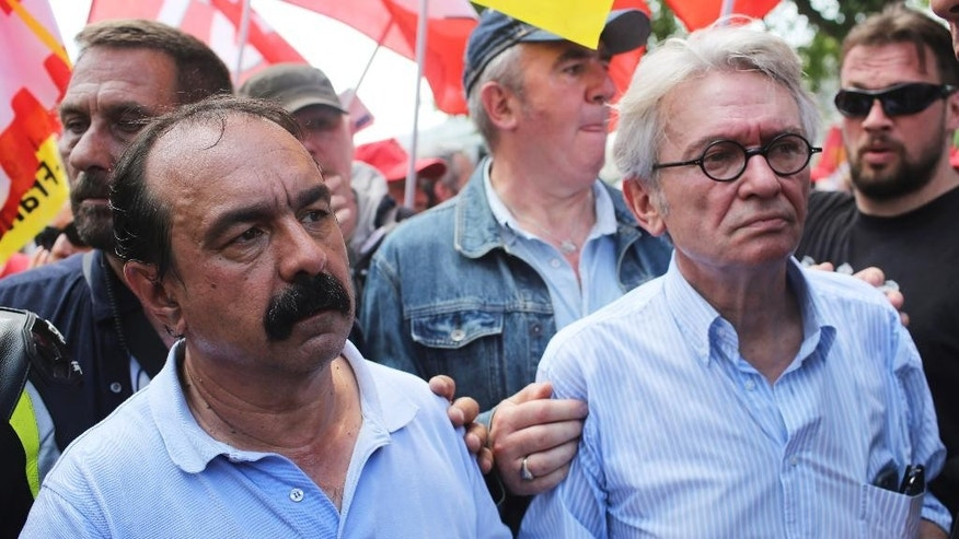 CGT Union leader Philippe Martinez, left, and FO union leader Jean-Claude Mailly lead a demonstration in Paris, Thursday, June 23, 2016. Unions are holding a short march Thursday around the Bastille plaza to protest government plans to make workweeks longer and layoffs easier. Similar protests against the legislation in recent months have degenerated into clashes between riot police and radicals. (AP Photo/Thibault Camus)