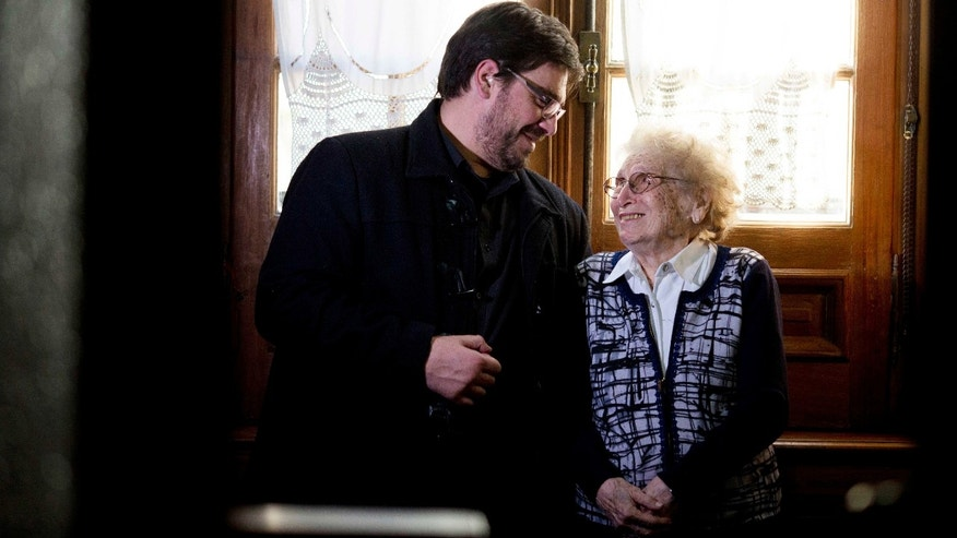 In this May 11, 2016 picture, Guillermo Perez Roisinblit, 38, and his 96-year-old grandmother Rosa de Roisinblit, smile at each as they pose for a photo in Buenos Aires, Argentina. Perez was Guillermo Gomez for decades before he was contacted by his biological sister and the Grandmothers of the Playa de Mayo, a human rights group that formed in 1977 to search for the disappeared of which his grandmother is vice president. They showed him a family picture; Perez was shocked by his resemblance to the man who would later be confirmed as his real father. (AP Photo/Natacha Pisarenko)
