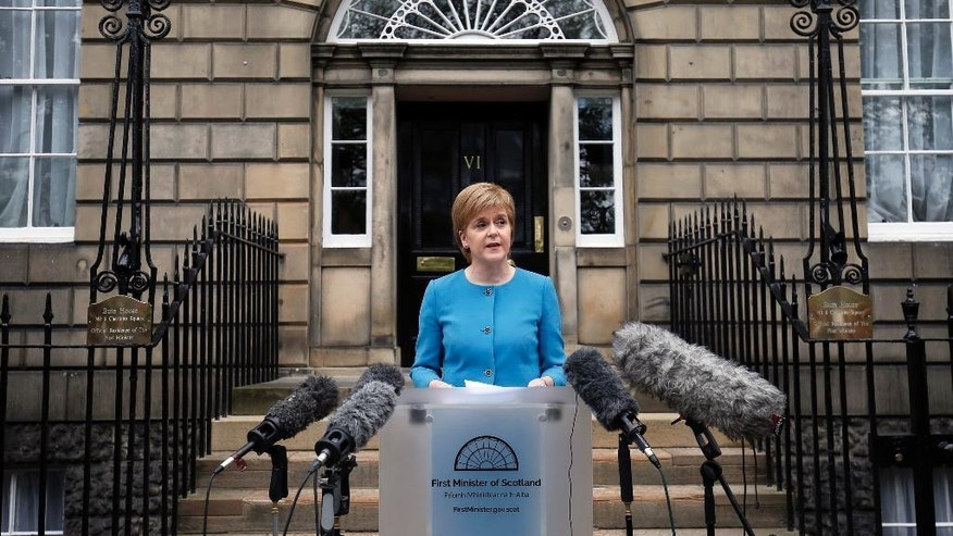 "First Minister Nicola Sturgeon speaks to the media outside Bute House,  following an emergency Scottish cabinet meeting in Edinburgh, Scotland, Saturday, June 25, 2016. Scottish leader Nicola Sturgeon says Scotland will launch immediate talks with European Union nations and institutions to find a way to remain in the bloc despite Britain's vote to leave. Sturgeon says voters in Scotland gave ""emphatic"" backing to remaining in the bloc. A majority of voters in more-populous England opted to leave. (Jane Barlow/PA via AP)     UNITED KINGDOM OUT      -     NO SALES       -     NO ARCHIVES"