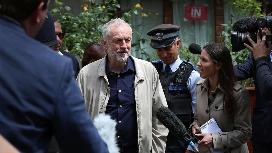 Labour party leader Jeremy Corbyn faces the media as he leaves his house in London, Sunday June 26, 2016.  Corbyn seems to be facing a revolt by some members of his shadow cabinet, as a string of shadow ministers have quit Sunday citing his leadership during the EU referendum campaign. (Isabel Infantes / PA via AP) UNITED KINGDOM OUT - NO SALES - NO ARCHIVES