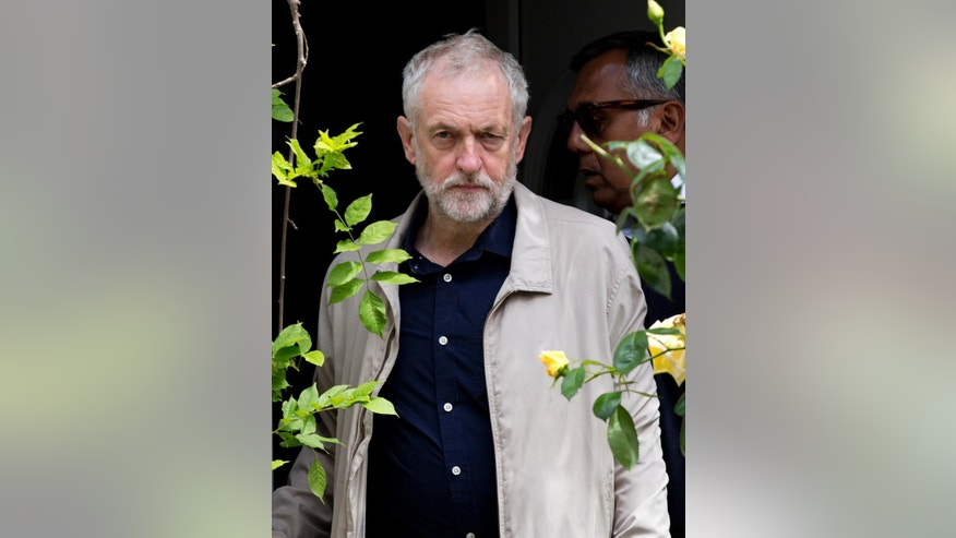 Labour leader Jeremy Corbyn leaves his house in London, Sunday June 26, 2016.  Corbyn seems to be facing a revolt by some members of his shadow cabinet, as a string of shadow ministers have quit Sunday citing his leadership during the EU referendum campaign. (Isabel Infantes / PA via AP) UNITED KINGDOM OUT - NO SALES - NO ARCHIVES