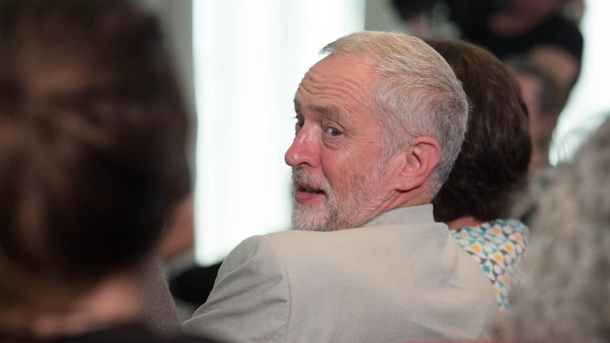 "Britain's opposition Labour party leader Jeremy Corbyn looks over his shoulder before delivering a speech on immigration and Britain's exit from the European Union, at the Maxwell Library in London, Saturday June 25, 2016.  Longtime critic of the EU, Coryn backed ""remain"" in Europe but some party members accuse him of failing to rally party supporters and may mount a bid to unseat him. (Stefan Rousseau / PA via AP) UNITED KINGDOM OUT - NO SALES - NO ARCHIVES"