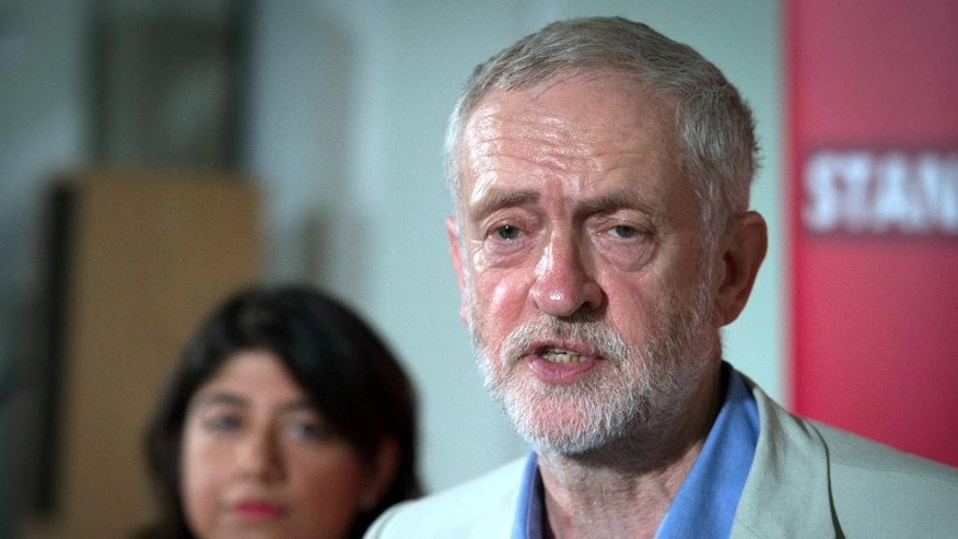 "Britain's Labour leader Jeremy Corbyn makes a speech at Savoy Place in London, Saturday, June 25, 2016. Corbyn, whose Labour Party backed a vote to stay in the bloc, says the areas that voted most strongly to leave are ""communities that have effectively been abandoned"" by economic change and the austerity policies of Britain's Conservative government. Many Labour lawmakers strongly backed ""remain"" and accuse the socialist Corbyn, a longtime critic of the EU, of failing to rally party supporters behind staying in the bloc. Several are trying to rally support behind a bid to unseat Corbyn. (Stefan Rousseau/PA via AP)    UNITED KINGDOM OUT       -    NO SALES      -      NO ARCHIVES"