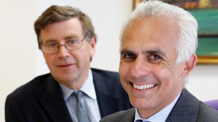 In this photo taken on Friday, June 3, 2016, Ben Habib, CEO of First Property Group, right, and George Digby, the company's group finance director pose for a photo at their office in London. The British were warned for weeks that a vote to leave the European Union would result in economic pain. Now they'll find out. The pound plunged to its lowest level in over 30 years on Friday, raising concerns about price inflation, and shares in the U.K.'s biggest banks and real estate builders posted double-digit declines as economists predicted the country would fall into recession. (AP Photo/Frank Augstein)