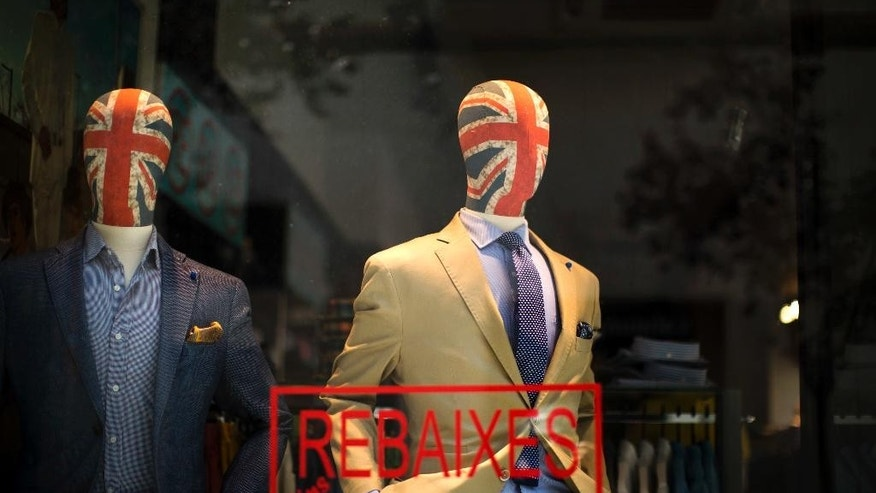 Mannequin with their heads decorated with Great Britain's union flag display fashion designers clothes in a tailoring shop in Barcelona, Spain, Sunday, June. 25, 2016. The news of the U.K. vote to quit the European Union is leaving British expatriates who have built lives abroad worrying what the vote may mean for their property, their pensions and their medical benefits.  (AP Photo/Emilio Morenatti)