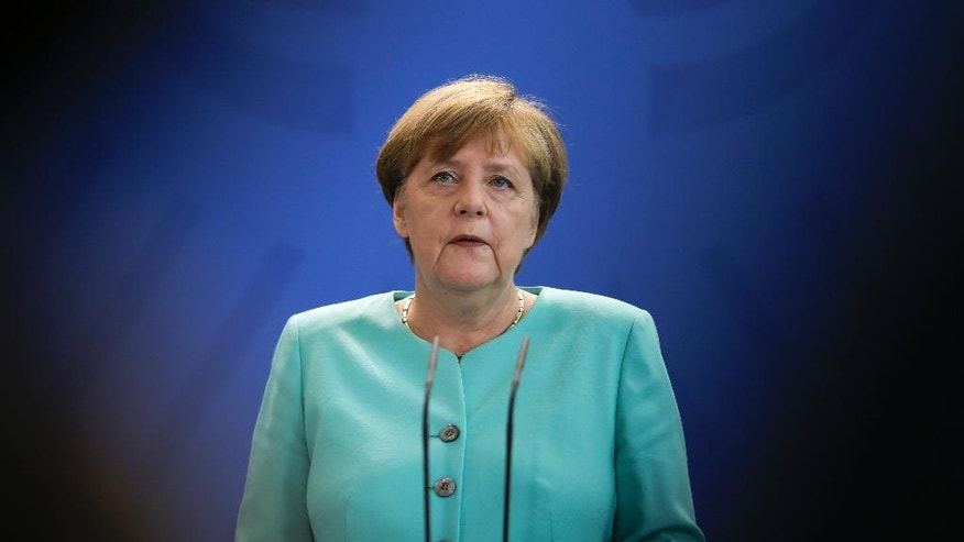 German Chancellor Angela Merkel speaks during a statement about the referendum in Britain at the chancellery in Berlin, Friday, June 24, 2016. Britain voted to leave the European Union after a bitterly divisive referendum campaign, according to tallies of official results Friday. (AP Photo/Markus Schreiber)