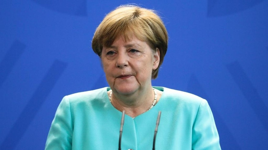 German Chancellor Angela Merkel speaks during a statement about the referendum in Britain at the chancellery in Berlin, Friday, June 24, 2016. Britain voted to leave the European Union after a bitterly divisive referendum campaign, according to tallies of official results Friday. (AP Photo/Markus Schreiber7
