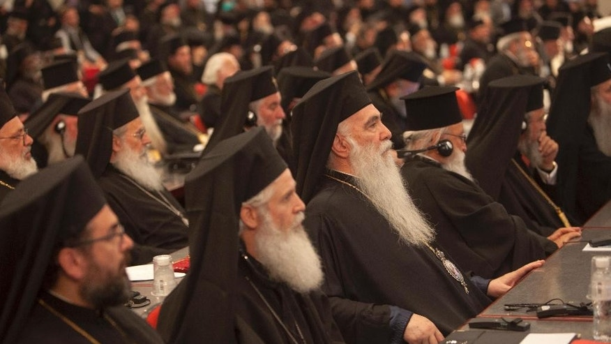 In this Saturday, June 25, 2016 photo released by Holy and Great Council, Orthodox Bishops attend the closing session of the Holy and Great Council at Kolymvari town on the island of Crete, greece. The leaders of the world's Orthodox Christian churches have gathered on the Greek island of Crete for a landmark meeting, despite a boycott by the Russian church and three other churches. (Sean Hawkey/ Holy and Great Council via AP)