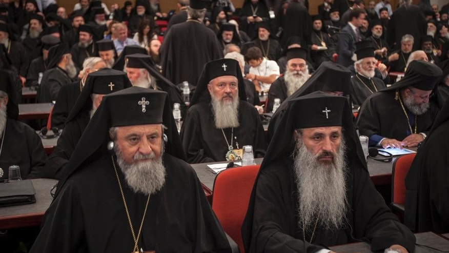 In this Saturday, June 25, 2016 photo released by Holy and Great Council, Orthodox Bishops attend the closing session of the Holy and Great Council at Kolymvari town on the island of Crete, Greece. The leaders of the world's Orthodox Christian churches have gathered on the Greek island of Crete for a landmark meeting, despite a boycott by the Russian church and three other churches. (Holy and Great Council via AP)