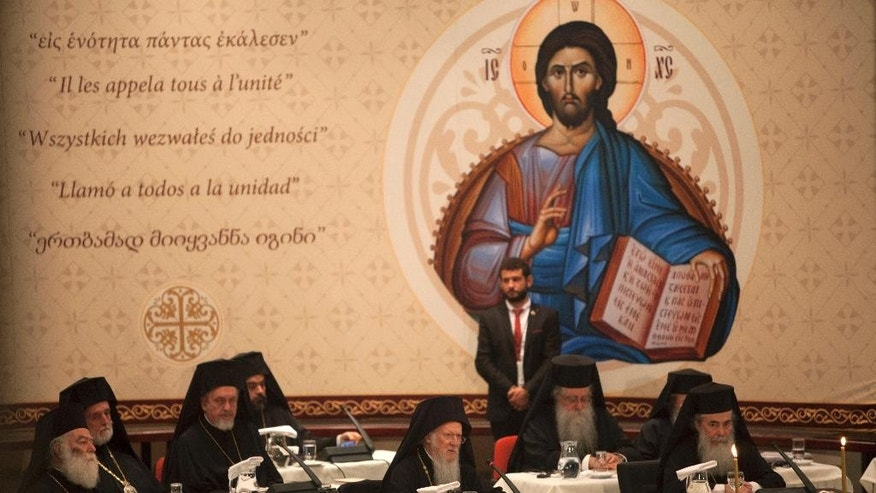 In this Saturday, June 25, 2016 photo released by Holy and Great Council, Ecumenical Orthodox Patriarch Bartholomew I, center, attends with other Patriarchs the closing session of the Holy and Great Council at Kolymvari town on the island of Crete, Greece. The leaders of the world's Orthodox Christian churches have gathered on the Greek island of Crete for a landmark meeting, despite a boycott by the Russian church and three other churches. (Holy and Great Council via AP)