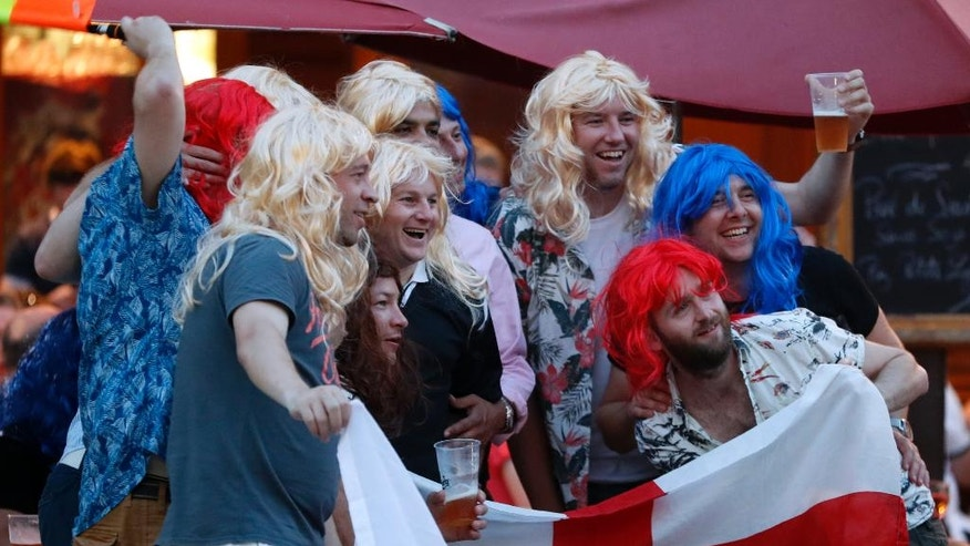 England soccer fans pose for a photograph in Nice, France, Sunday, June 26, 2016, a day ahead of the Euro 2016 round of 16 soccer match between England and Iceland. (AP Photo/Darko Bandic)