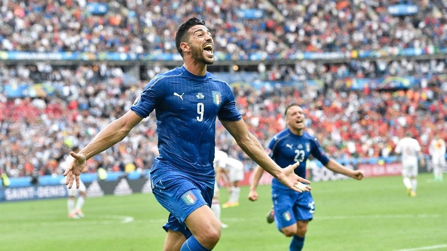 Italy's Graziano Pelle celebrates after scoring his side's second goal during the Euro 2016 round of 16 soccer match between Italy and Spain, at the Stade de France, in Saint-Denis, north of Paris, Monday, June 27, 2016. (AP Photo/Martin Meissner)
