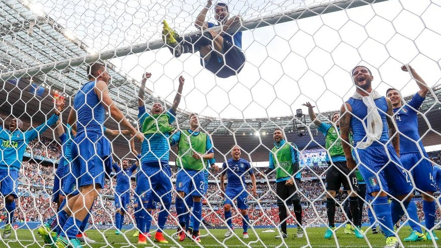 Italy goalkeeper Gianluigi Buffon, center, and his teammates celebrate at the end of the Euro 2016 round of 16 soccer match between Italy and Spain, at the Stade de France, in Saint-Denis, north of Paris, Monday, June 27, 2016. (AP Photo/Martin Meissner)