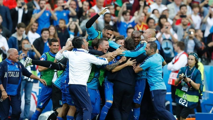 Italy players celebrate after Graziano Pelle scored, during the Euro 2016 round of 16 soccer match between Italy and Spain, at the Stade de France, in Saint-Denis, north of Paris, Monday, June 27, 2016. (AP Photo/Frank Augstein)