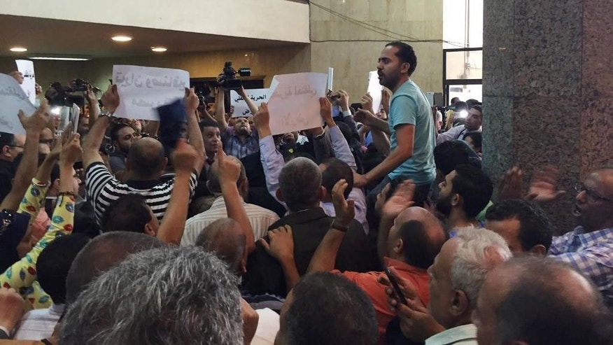 People protest at an appeals court hearing in Cairo, Egypt.  Egypt's government on Sunday defended its decision to hand over two Red Sea islands to Saudi Arabia at after the move was struck down by a lower court last week. (AP Photo/Hamza Hendawi)