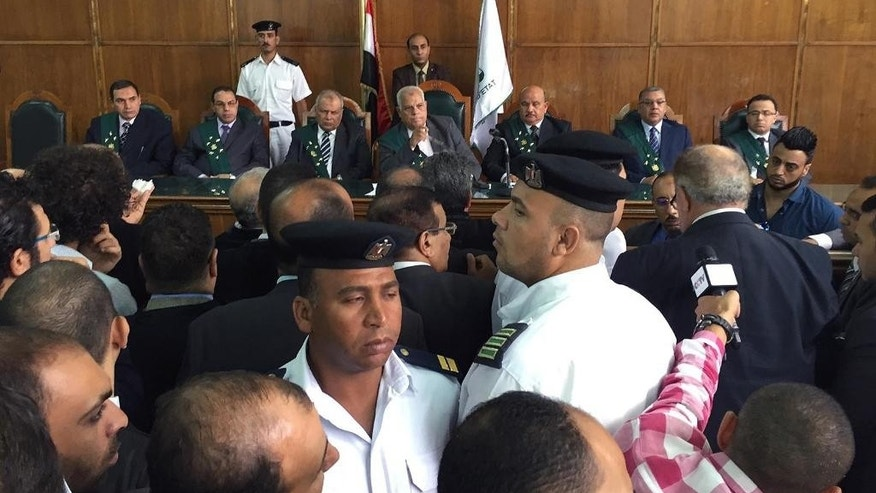 Chief government lawyer, Rafiq Omar, center, at an appeals court hearing in Cairo, Egypt.  Egypt's government on Sunday defended its decision to hand over two Red Sea islands to Saudi Arabia at after the move was struck down by a lower court last week. (AP Photo/Hamza Hendawi)