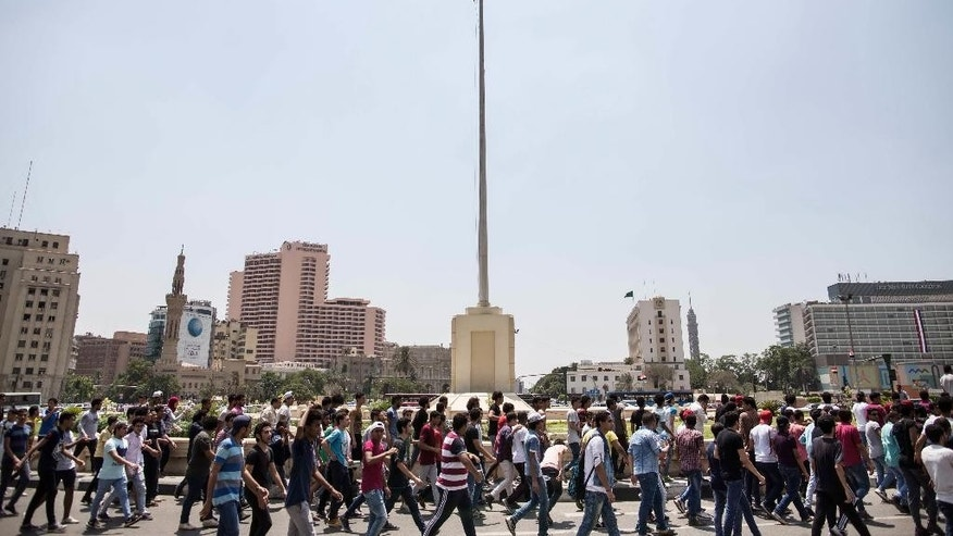 Hundreds of Egyptian students march during a protest against the cancellation of high school exams, in Cairo, Egypt, Monday, June 27, 2016. Demanding the resignation of Education Minister Al-Helali el-Sherbini, the students, accompanied by some parents, later marched toward Tahrir Square, the epicenter of Egypt's 2011 uprising against longtime autocrat Hosni Mubarak. (AP Photo/Roger Anis)