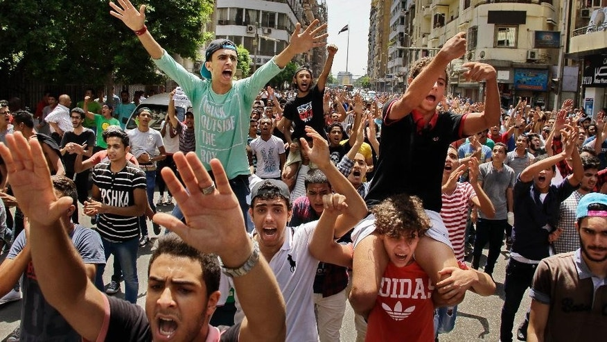 Hundreds of Egyptian students chant slogans during a protest against the cancellation of high school exams, in Cairo, Egypt, Monday, June 27, 2016. Demanding the resignation of Education Minister Al-Helali el-Sherbini, the students, accompanied by some parents, later marched toward Tahrir Square, the epicenter of Egypt's 2011 uprising against longtime autocrat Hosni Mubarak. (AP Photo/Ahmed Abd El Latif)