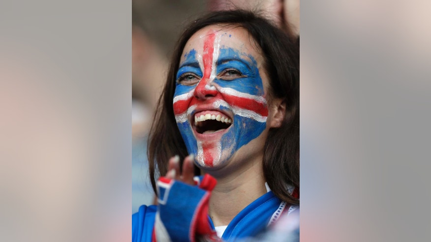 An Iceland supporter smiles prior to the Euro 2016 round of 16 soccer match between England and Iceland, at the Allianz Riviera stadium in Nice, France, Monday, June 27, 2016. (AP Photo/Pavel Golovkin)