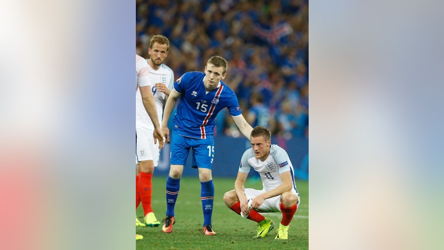 Iceland's Jon Dadi Bodvarsson pats England's Jamie Vardy on the back at the end of the Euro 2016 round of 16 soccer match between England and Iceland, at the Allianz Riviera stadium in Nice, France, Monday, June 27, 2016. (AP Photo/Kirsty Wigglesworth)