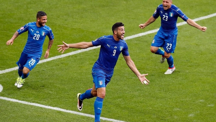 Italy's Graziano Pelle, center, celebrates after scoring his side's second goal during the Euro 2016 round of 16 soccer match between Italy and Spain, at the Stade de France, in Saint-Denis, north of Paris, Monday, June 27, 2016. (AP Photo/Francois Mori)