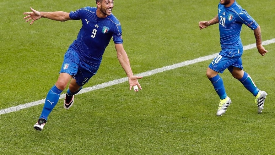 Italy's scorer Graziano Pelle, left, and his teammate Lorenzo Insigne, right, celebrate their side's second goal during the Euro 2016 round of 16 soccer match between Italy and Spain, at the Stade de France, in Saint-Denis, north of Paris, Monday, June 27, 2016. (AP Photo/Francois Mori)